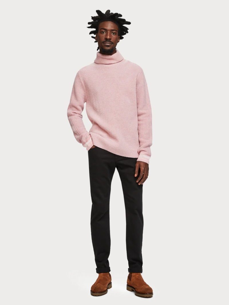 An unusual pink-hued wool-cashmere blend pullover teamed with black jeans for a smart/casual urban look.