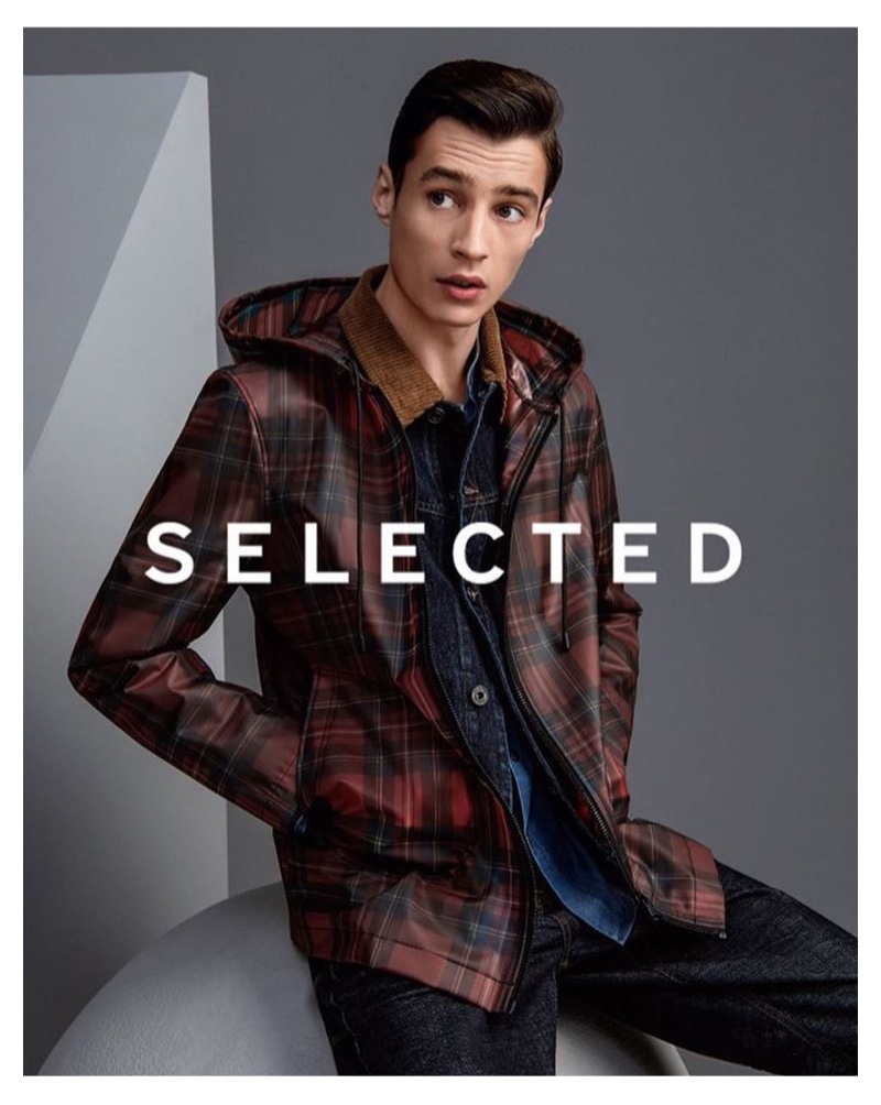 Donning a checked jacket, Adrien Sahores appears in Selected China's fall-winter 2019 campaign.