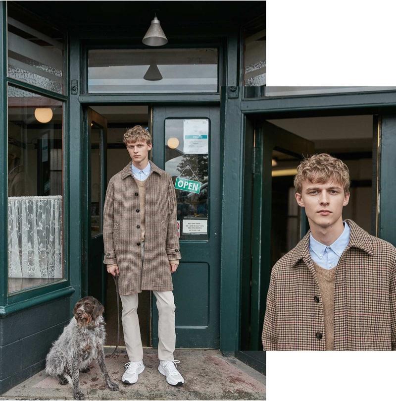 Max Barczak dons a checked coat for Sfera's fall 2019 campaign.