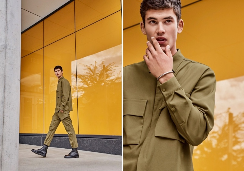 Embracing a neutral color palette, Finn Hayton models a minimalist utilitarian shirt and modern cargo pants from LE 31.