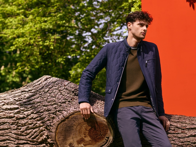 Hannes Gobeyn wears a quilted jacket with a textured sweater from Ted Baker.