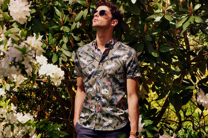 Making a case for tropical prints, Hannes Gobeyn wears a short-sleeve shirt by Ted Baker.