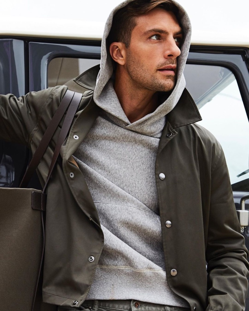 Going sporty, Rafael Lazzini wears a Todd Snyder coach's jacket $498 with a Todd Snyder + Champion hoodie $138.