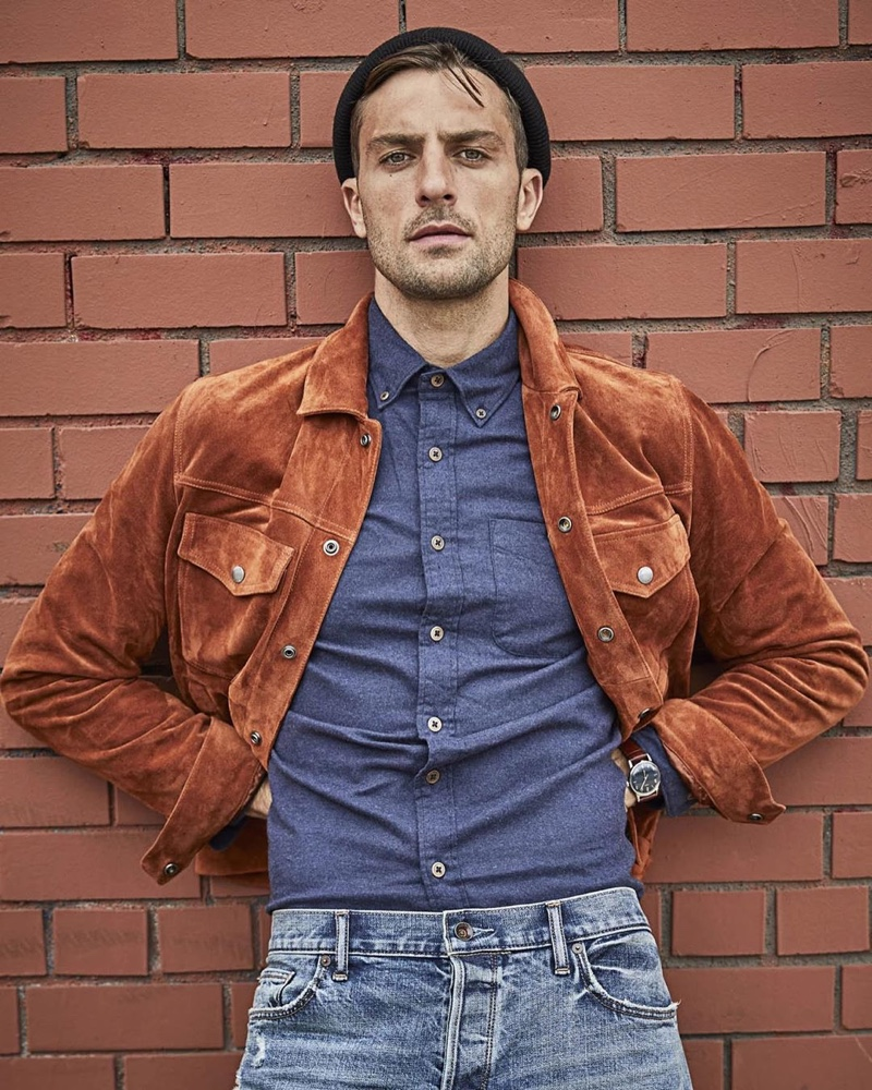 Standing out in a beautiful rust color, Rafael Lazzini dons a Todd Snyder Italian suede jacket $998 with a brushed cotton cashmere shirt $178 in navy and distressed denim jeans.