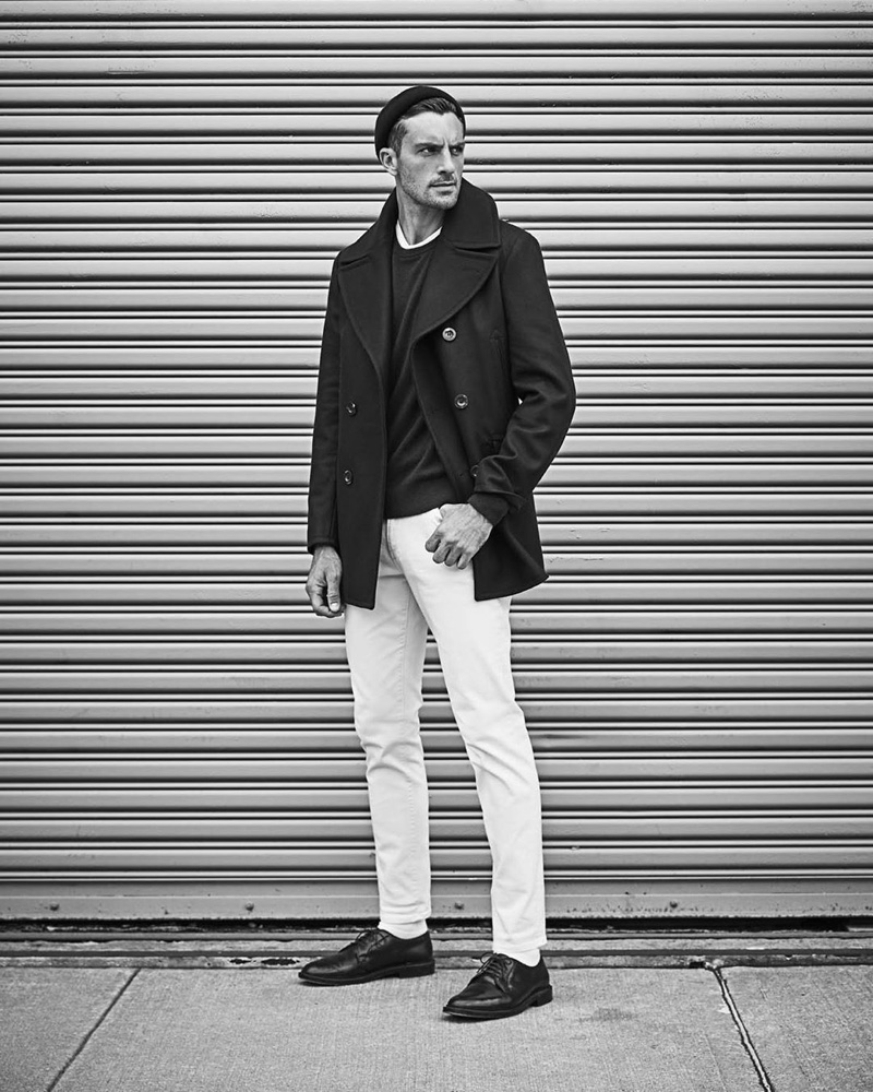 Making a classic statement, Rafael Lazzini models a Todd Snyder + Private White Manchester wool peacoat $998 in navy with Todd Snyder white denim jeans $198.
