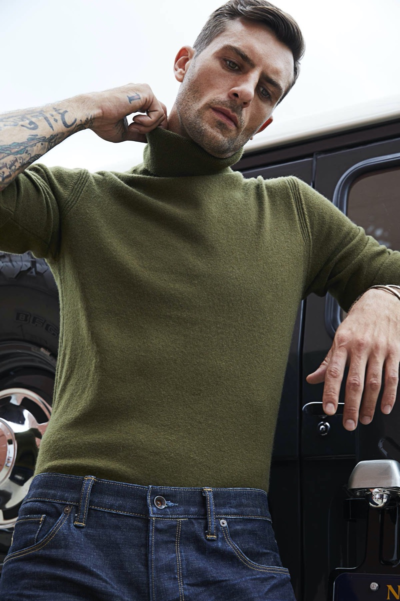 A chic vision, Rafael Lazzini dons a Todd Snyder cashmere turtleneck sweater $328 in olive.
