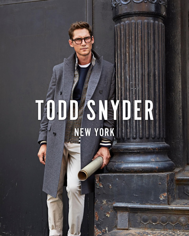 A smart vision, Roch Barbot wears a Todd Snyder Italian cashmere double-breasted topcoat $1,798 and chinos with a Todd Snyder + Golden Bear Harris tweed jacket $998.