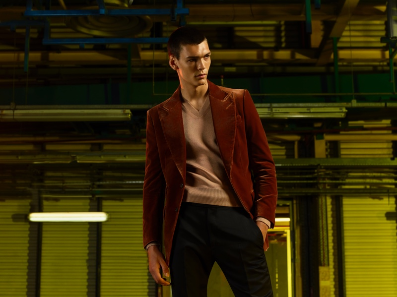 Embracing autumnal tones, Hugh Burry models a look from the Tom Ford x Mr Porter capsule collection.