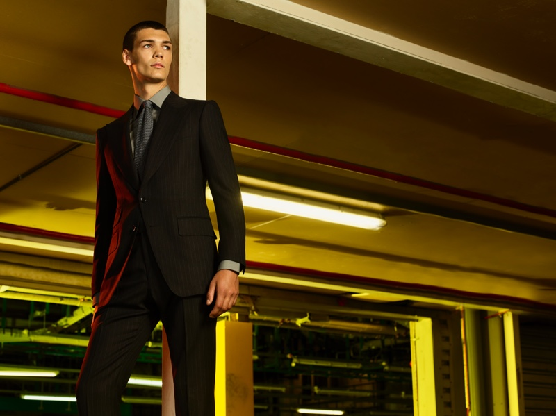 A sharp vision, Hugh Burry sports a tailored suit from the Tom Ford x Mr Porter capsule collection.