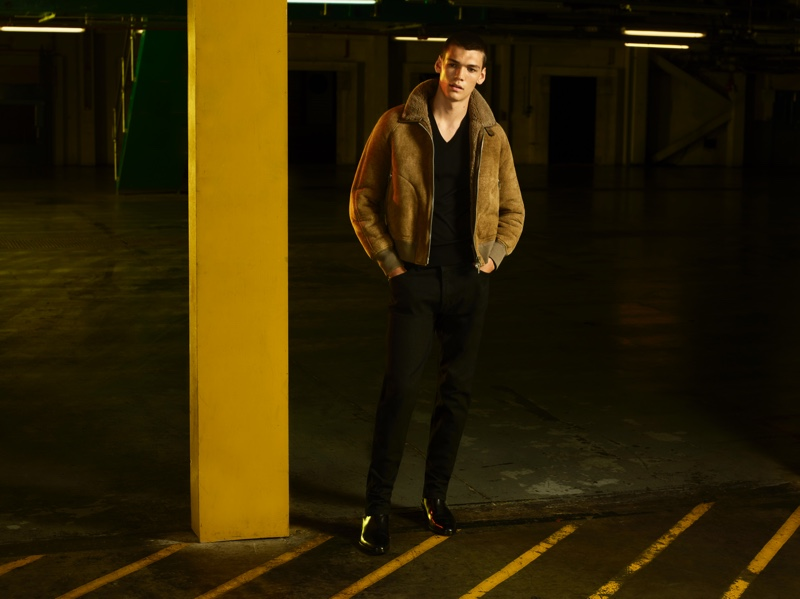A sleek vision, Hugh Burry wears a suede bomber jacket from the Tom Ford x Mr Porter capsule collection.