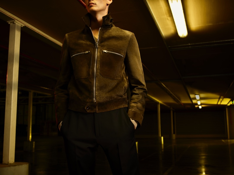 Model Hugh Burry dons a suede jacket from the Tom Ford x Mr Porter capsule collection.