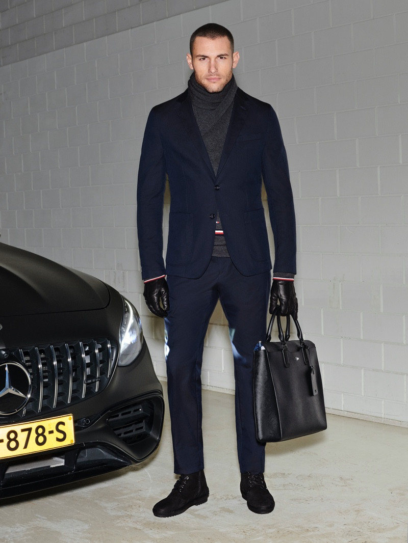 Corey Saucier suits up in a navy look from the Tommy x Mercedes-Benz fall-winter 2019 collection.