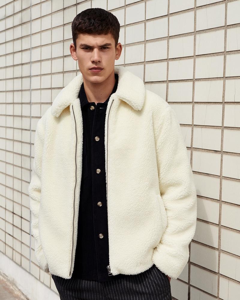 Sporting a white fleece jacket, Finn Hayton stars in Topman's fall 2019 campaign.