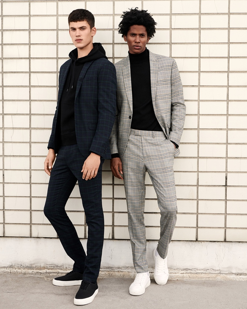 Sporting checked suits, Finn Hayton and Rafael Mieses star in Topman's fall 2019 campaign.