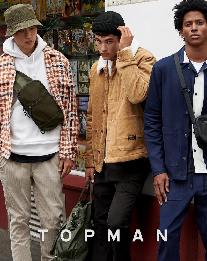 Models Ryu Wankyu, Finn Hayton, and Rafael Mieses front Topman's fall 2019 campaign.