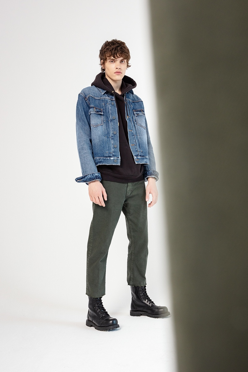 Philip Lunin models denim fashions from Two Men's fall-winter 2019 collection.
