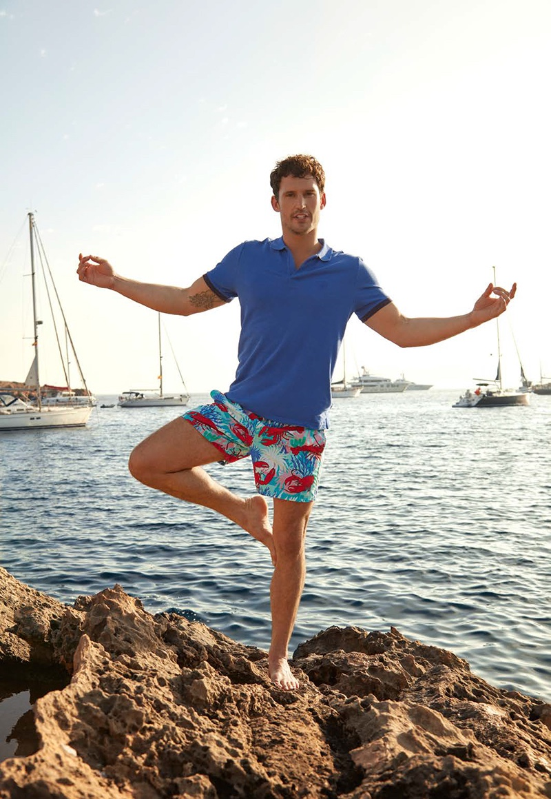 Front and center, Sam Webb wears a blue Vilebrequin polo shirt $115 with Homards & Coraux swim trunks $260.