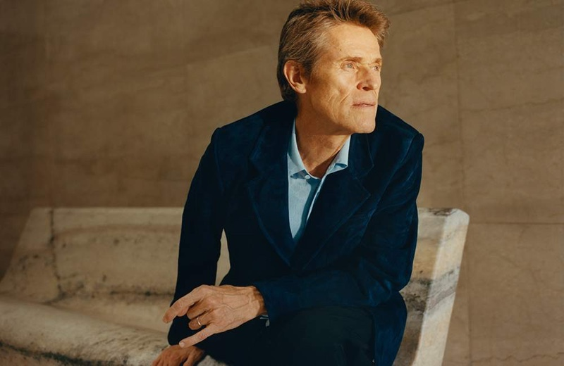 Front and center, Willem Dafoe dons Prada trousers.
