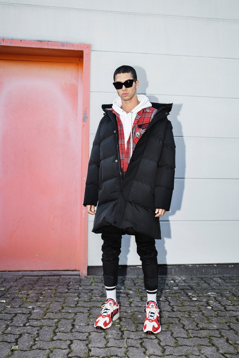 A cool vision, Daniel Angulo models an Autarak jacket with G-Star pants and a shirt and hoodie by Diesel.