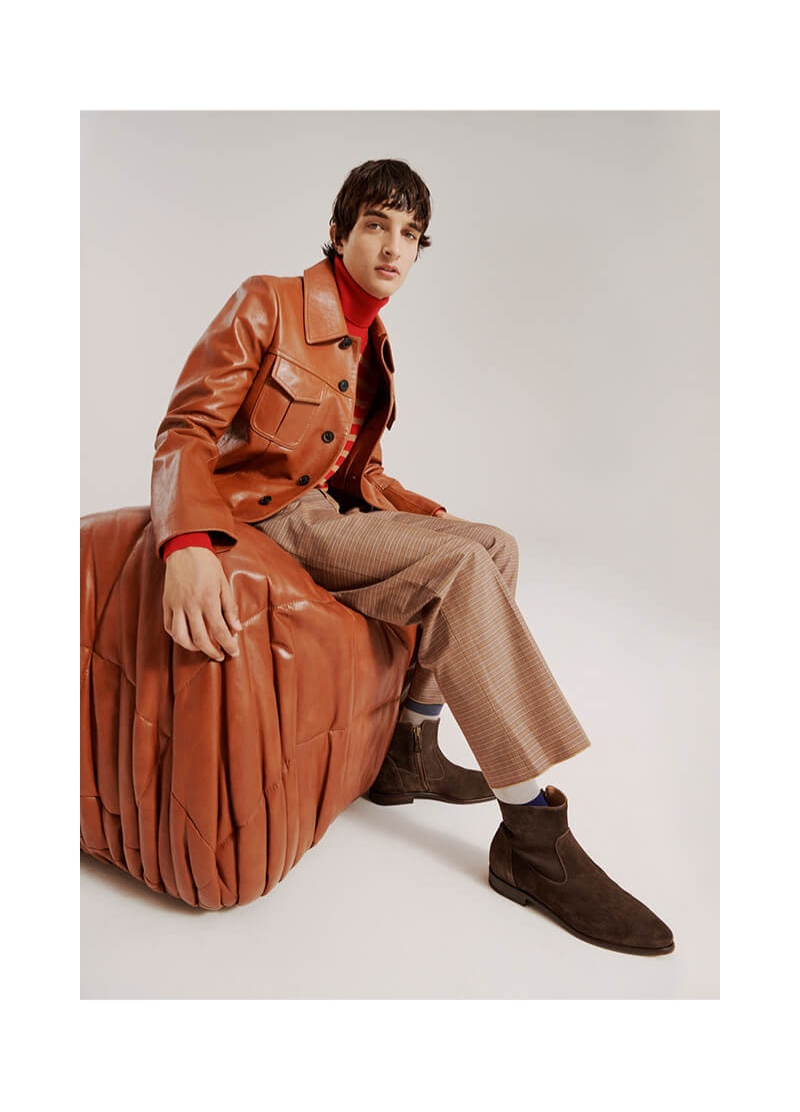 Pablo Fernandez sports a Maison Margiela leather jacket with checked Marni trousers.