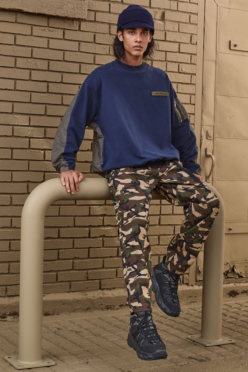 Jordy (Claude Management) wears a sweatshirt and camouflage print pants from Zara SRPLS' fall-winter 2019 collection.