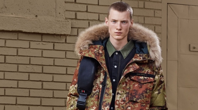 Braien Vaiksaar sports a digital camouflage print parka with denim from Zara SRPLS' fall-winter 2019 collection.