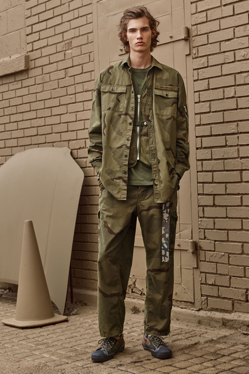 Lukas Gomann rocks a camouflage print shirt and cargo pants from Zara SRPLS' fall-winter 2019 collection.