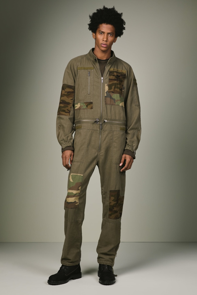 Rafael Mieses makes a military style statement in a jumpsuit from Zara SRPLS' fall-winter 2019 collection.