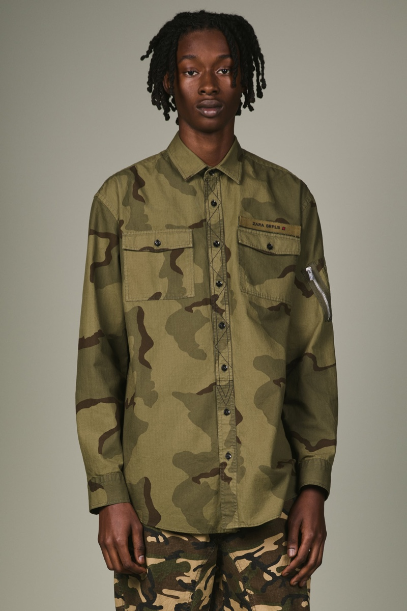 Abdulaye Niang wears a camouflage shirt and pants from Zara SRPLS' fall-winter 2019 collection.