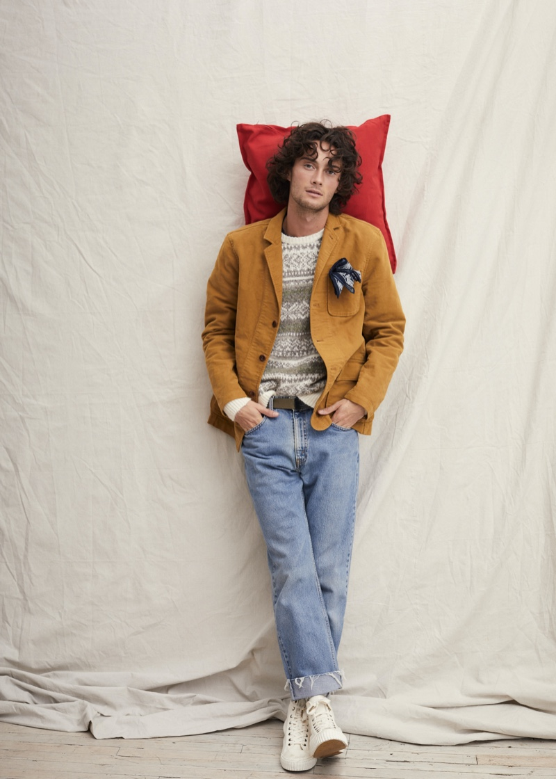 A smart vision, Oli Green wears an unlined blazer with a fairisle sweater and straight-cut denim jeans by Alex Mill.
