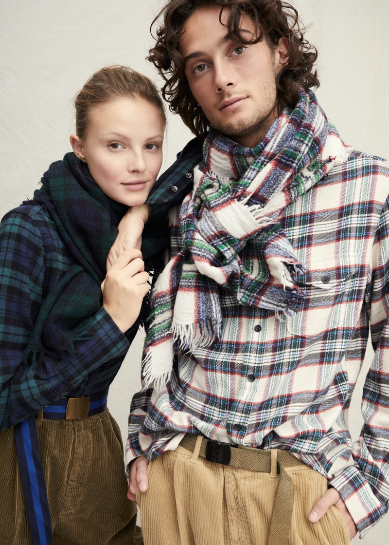 Mad for plaid, Oli Green sports a tartan shirt and scarf with corduroy pants by Alex Mill.