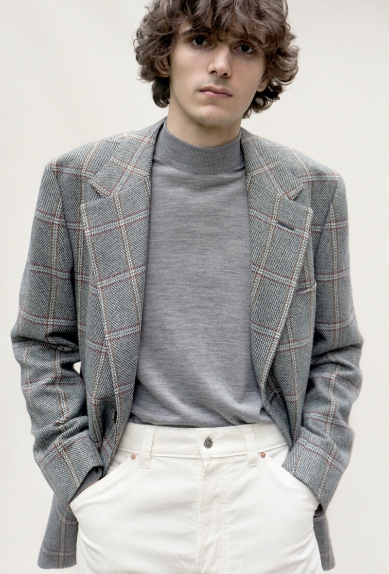 Massimo Colonna wears a Camoshita jacket with a John Smedley mock neck sweater and Drake's trousers.