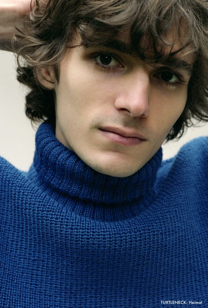 Model Massimo Colonna sports a blue turtleneck sweater by Heimat.
