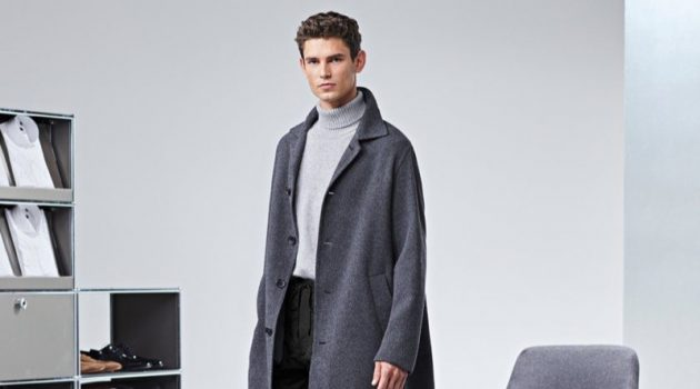 Arthur Gosse dons an oversized gray coat by BOSS.