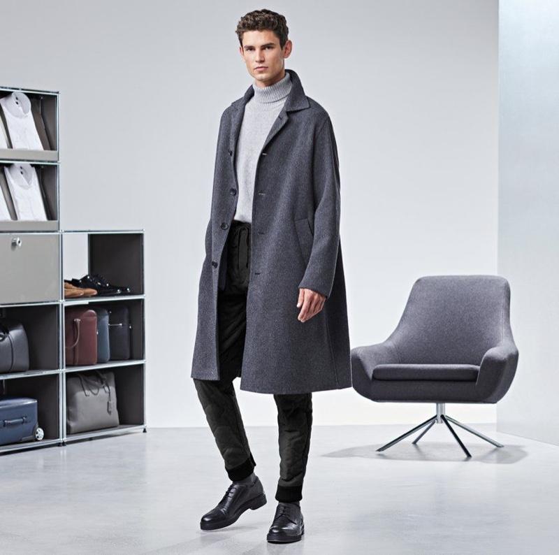 Arthur Gosse dons an oversized gray coat by BOSS.