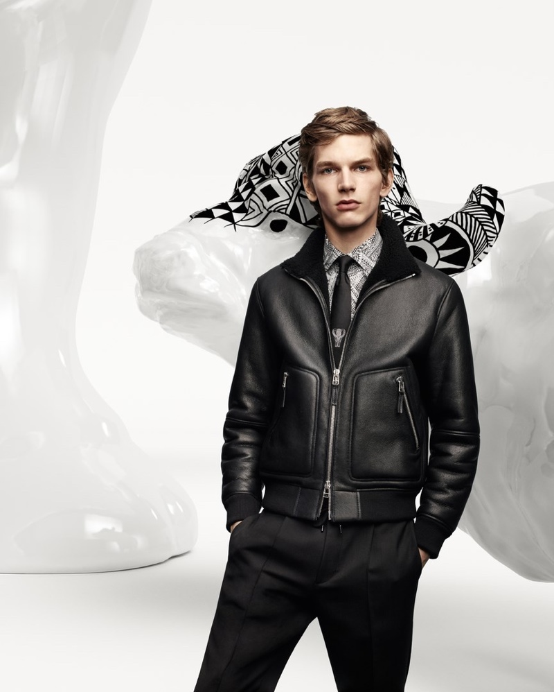 Erik van Gils sports a leather jacket for the BOSS x Meissen holiday campaign.