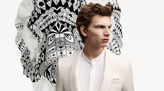 A sharp vision in a white evening look, Erik van GIls fronts the BOSS x Meissen holiday campaign.
