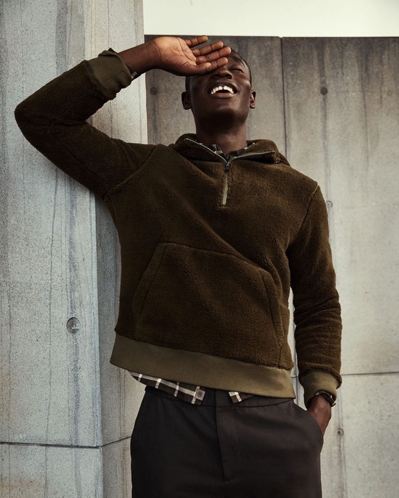 All smiles, Charles Oduro sports a brown fleece pullover from Banana Republic.