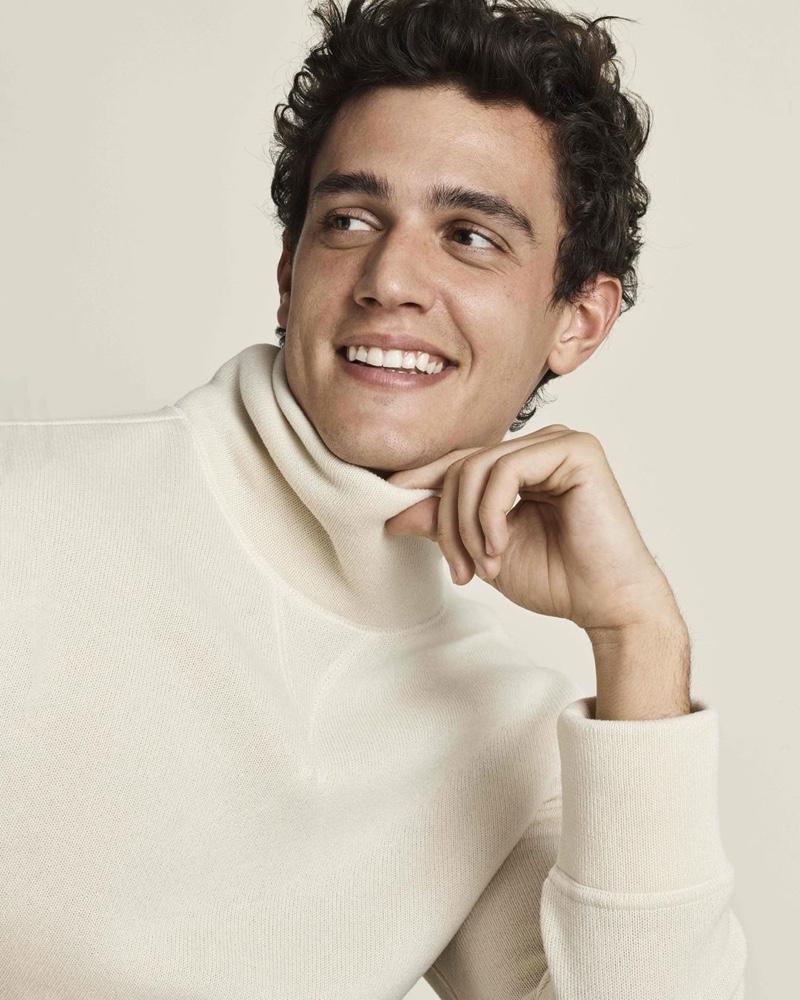 Smiling ear to ear, Xavier Serrano models a cozy knit from Banana Republic.