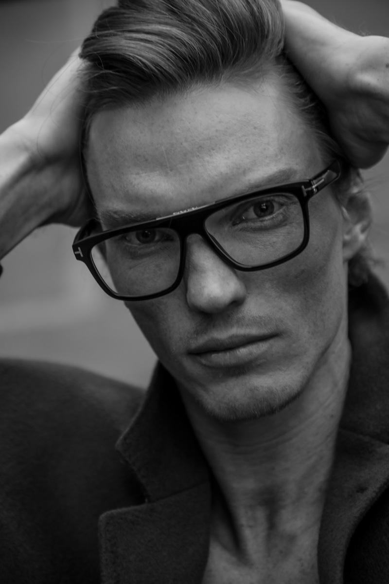 Ready for his close-up, Bruno Novodvorski wears black-framed glasses.