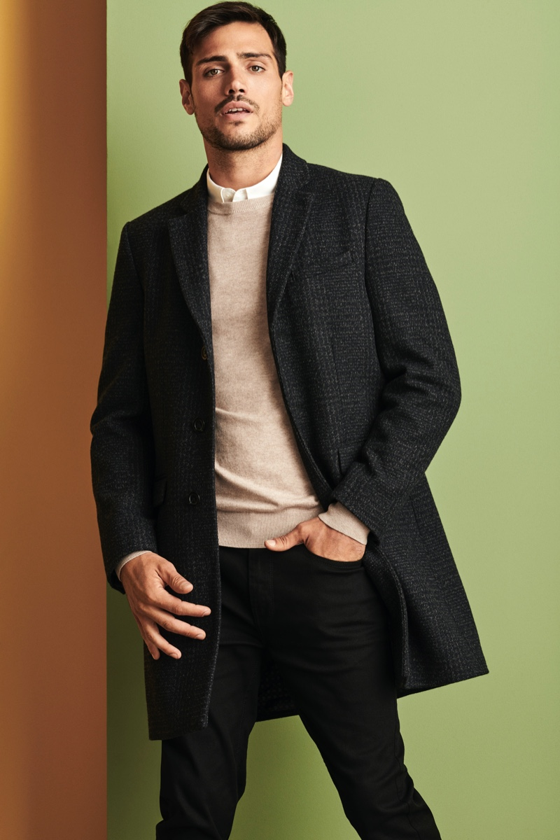 Donning a coat, sweater, shirt, and pants, Richard Deiss sports an essential look from Burton.