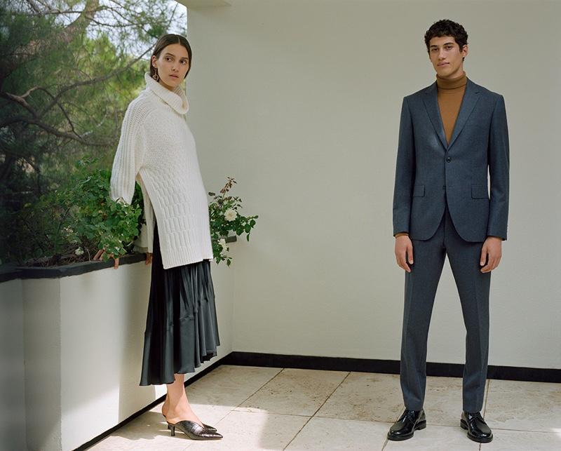 Dressed to impress, Malik Al Jerrari wears Club Monaco's Grant wool flannel blazer and trousers with a turtleneck sweater.