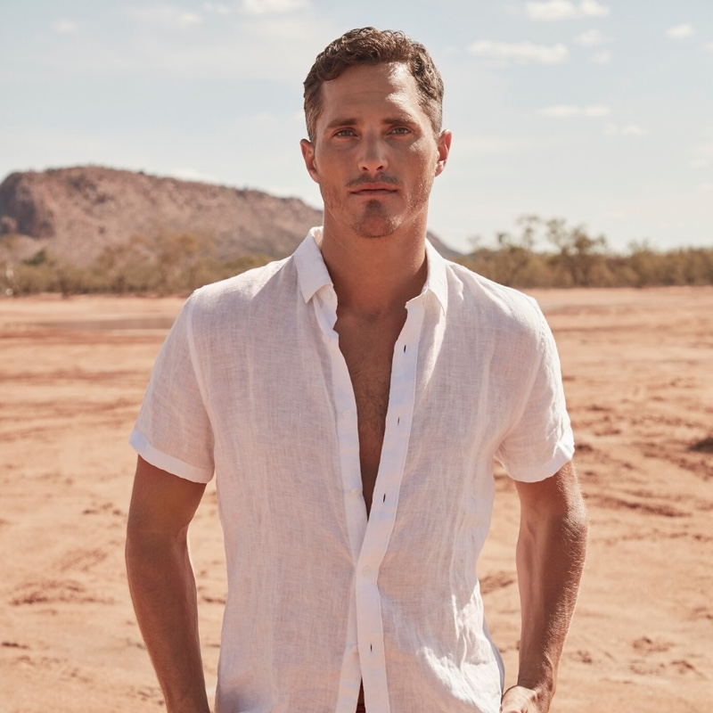 Ollie Edwards dons a white linen short-sleeve shirt from Country Road.