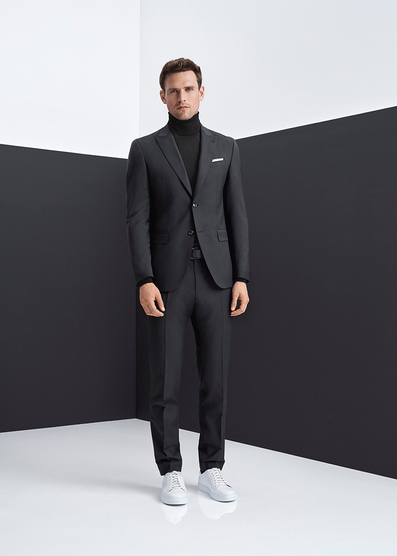 British model Guy Robinson dons a mix-and-match suit with a classic turtleneck sweater from Digel.