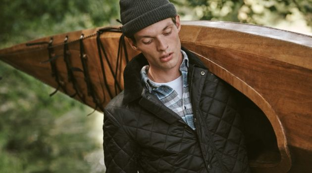 Model Rocky Harwood dons a Barbour plaid shirt and quilted jacket with a POLO Ralph Lauren pocket tee.