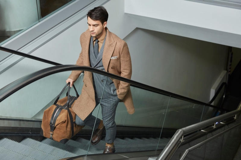 Taking on the role of the traveling man, Aleksandar Rusić stars in Eleventy's fall-winter 2019 campaign.