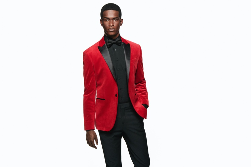 A dapper vision in a red and black tuxedo jacket, Salomon Diaz appears in Express' holiday 2019 campaign.