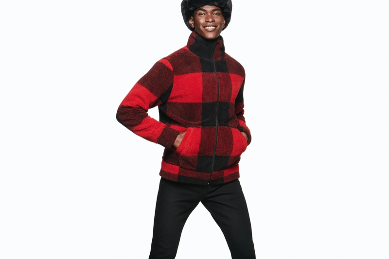 Rocking a red and black buffalo check jacket, Salomon Diaz spreads joy with Express' holiday 2019 campaign.