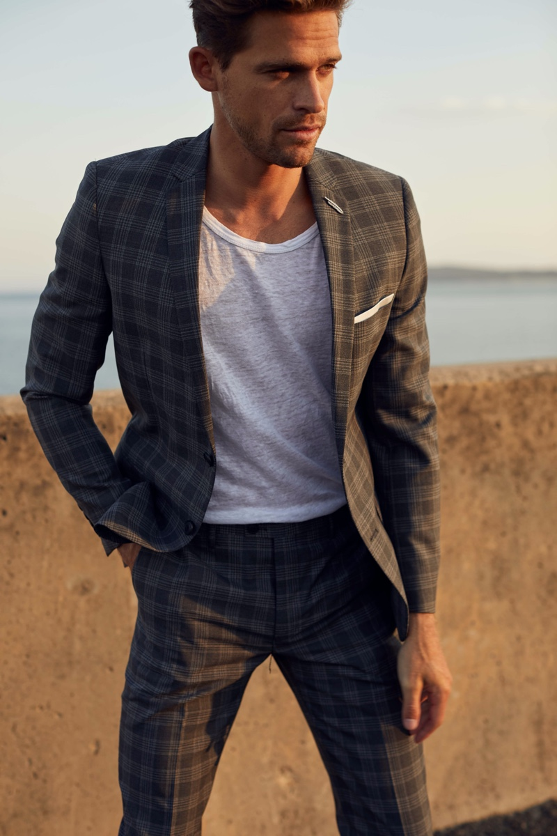 Broed wears checked gray suit Jack London and tee Venroy.