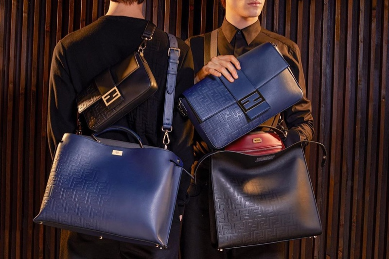 Models Yang Hao and Liam Kelly pose with Fendi's covetable bags for the season.